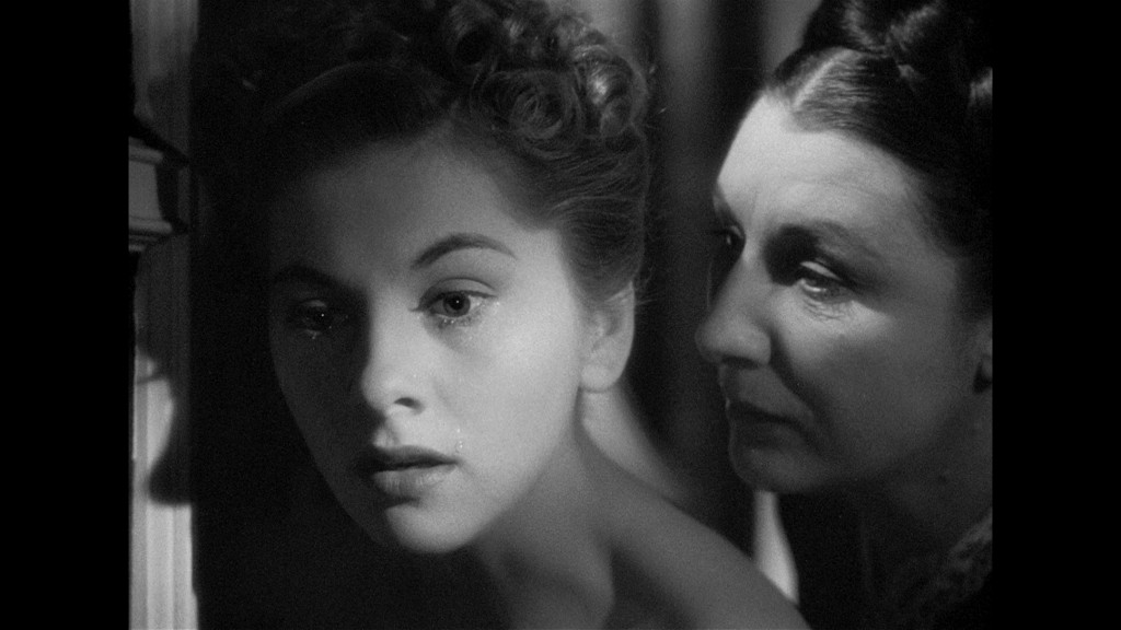 The soft Joan Fontaine and the hardened Judith Anderson in REBECCA.